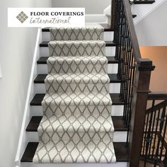 This carpet stair runner is the perfect blend of texture, color, and pattern. It is clearly a focal point of this space in the home, without overpowering the grand, multi-level stair case, wrought iron spindles, and dark wood stairs.