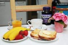 free breakfast (with toast, coffee, juice, jam, fruits, egg)