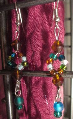 """multi colored glass beads ; silver findings     2  1/2 """" long poduct #E014 $10.00"""