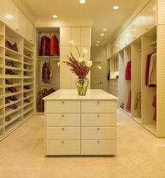 Very simple and stylish contemporary closet featuring shades of beige and red