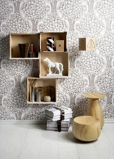 this. i like this. boxes screwed to a wall = storage & deco.