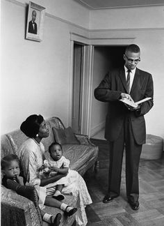 Malcolm X, wife Betty Shabazz, and daughters Attallah and Qubilah, circa 1962.