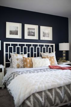 """Sandie and Jessica made one BIG change: painting over the red walls with <a href=""""http://m.valsparpaint.com/color-detail.php?id=2075&g=1020"""" target=""""_blank"""">Valspar navy paint</a>. This helped tie in everything, especially the gray carpeting."""