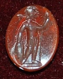 Red-orange cornelian intaglio: warrior to left.