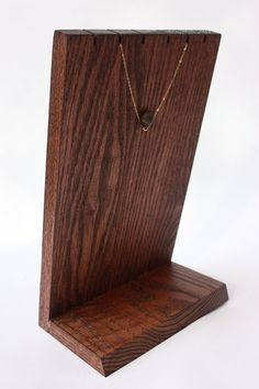 This simple, original and attractive handmade wooden necklace display has a rustic feel to it. Its made from red oak, which has then been
