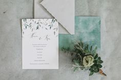 Wedding invitation with eucalyptus  leaf-illustrations and handmade envelope.
