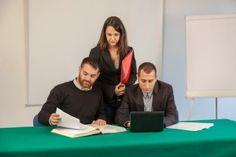 Three Professionals Participate in Planning Meeting