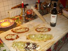 our homemade pizza with broccoli  and radicchio with mozzarella cheese and pizza margherita, Good Chianti red wine