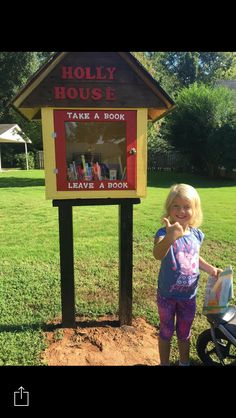 """A precious visitor to our """"Holly House"""" Little Free Library."""