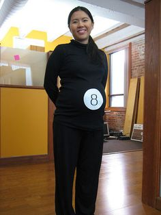 """Magic 8 Ball In the future will you have a baby? Magic 8 ball says, """"yes!"""" This adorable Magic 8 Ball costume takes less than five minutes to make. Simply wear all black, print an a piece of paper, cut it into a circle, and tape it to your belly! Pregnancy Costumes, Pregnant Halloween Costumes, Pregnancy Humor, Maternity Halloween, Maternity Costumes, Funny Maternity, Maternity Style, Maternity Photos, Creative Halloween Costumes"""