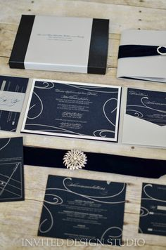 boxed wedding invitation suite with rhinestone buckles, step mounts, pocket and rsvp belly band.  By Invited Design Studio