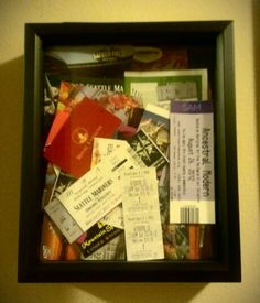 My husband and I save tickets, hotel key cards, small pamphlets and other little trinkets from that year in a decorative bowl on a bookshelf. At the end of the year we put everything in a shadow box with the date on the back and hang it in the wall. It's fun to look back at the things you did and fun you had that year. I'm sure it will be fun to look back on in 10 years!
