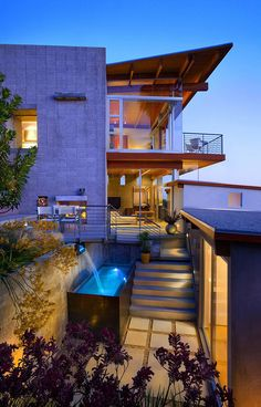 Architecture, Beautiful Beach House Design Captured From Beside At Night Showing Natural Pool Under Relaxation Place With White Dinning Chairs: Beach House with Traditional Wooden Decor and Stylized with Modern Furniture