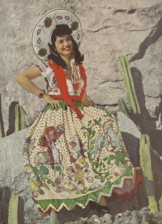 Beautiful Mexican Senorita in a great traditional outfit.