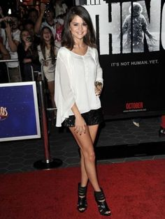 Selena Gomez takes shorts to a new level. Pair glittery shorts with strappy sandals and a loose tee for a night out.