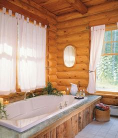 This log home bathroom features plenty of natural light. www.hiawatha.com