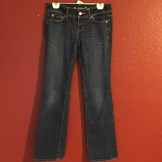 "American eagle Jeans size 4 boot cut long American eagle jeans in excellent condition. Slight very slight hem wear. Size 4 long. Waist: 16"" inseam: 33"" rise 7"". Low rise. No stains or holes. Just light hem wear. American Eagle Outfitters Jeans Boot Cut"