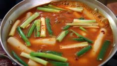 ddeokbokki (Toppoki - Korean rice cake in spicy sauce with green onion)