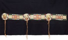 American Indian Art:Beadwork and Quillwork, A CROW OR PLATEAU QUILLED AND BEADED BUFFALO HIDE BLANKET STRIP. c.1860...