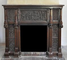 Neo-Gothic style fireplace made out of oak wood withpanels carved in low relief.