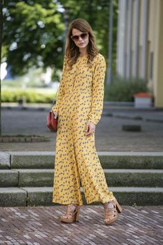 There are so many fresh takes on the '70s this season. Get in on the fun with a silk jumpsuit in an all-over print.
