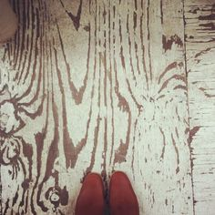 worn painted plywood flooring