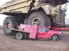 Earth Mover Flattens Utility Truck.This is the 240 ton 2,105 hp Caterpillar 793B