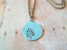 Super cute necklace! Turquoise Blue Hand Painted Tree Pendant Necklace by handmadebyfirefli on etsy.