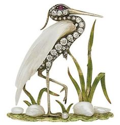 Vintage crane brooch featuring white topaz, garnet, freshwater pearls and mother of pearl set in sterling silver with enamel accents, circa 1910