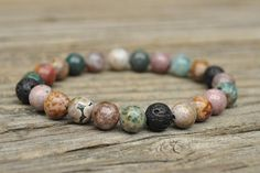 I T E M - D E T A I L S -- Gemstone mala bracelet - with non latex stretch cord 8 mm smooth rounds of Ocean Jasper gemstone beads and Lava diffuser beads Made to order -- C H A K R A - G R O U P -- Solar Plexus  -- M A I N - F O C U S - A R E A -- Meditation, Joy, Optimism  -- A D D I T