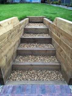 Finished retaining sleeper wall, steps, block paving driveway and exterior LED garden lighting
