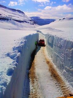 This is my hubbys work for the last 4 days now,,, Still have about 6-8 days left of snowblowing the road between Egilsstadir and Mjoifjordur East - Iceland... The snowbanks in the picture are far from being the thickest ones at about 4 meters / 13.1 ft... One man predicts they will go up to 19 ft thick!!!!! Iceland today, May 25th... (Thinking about driving up there myself tomorrow and see this for myself ) :)