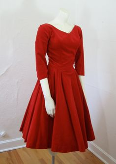 1950's velvet dress. So for me... In blue, cotton, a less full skirt... I like this style, it is very flatering to a full figure...