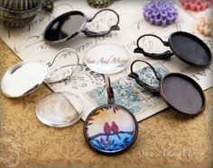 You can turn any image (as far as the law will allow!) into a glass cabochon for jewelry with these kits!