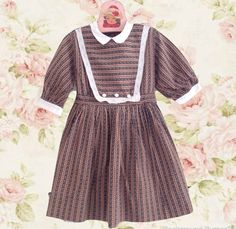 Vintage 1950s cotton girls dress Soft cotton dress with a button down bib design Gathered skirt and white netting petticoat 3/4 Length