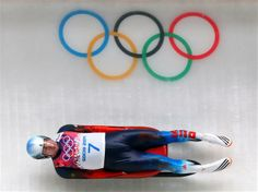 Albert Demchenko of Russia makes a run during the Luge Men's Singles
