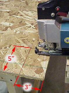 Cutting notches for lower shelf on workbench.