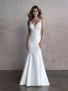 25711 - Gwen - Stunning is an understatement. This fit and flare wedding gown has it all! Try this beauty on at Aurora Bridal in Melbourne, FL 321-254-3880
