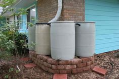 multiple rain barrels connected in series to capture overflow