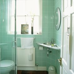 Shower room with turquoise tiles, large window and white door