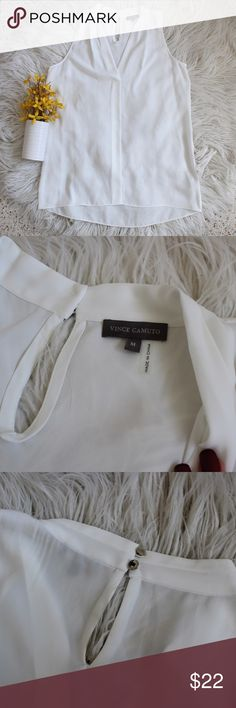 "Vince Camuto White Sleeveless Blouse So simple and pretty. Sheer chiffon like fabric. Size large. Excellent condition! Silver buttons on back that says ""Vince Camuto"" Vince Camuto Tops"