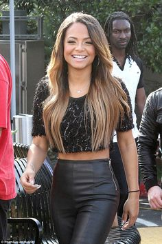 Top tummy: Christina Milian flaunted her trim figure in a sequin black crop top and high-w...