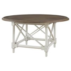 Gather family and friends for weekend soirees and casual meals around this country-chic dining table, featuring a crossed panel base and weathered detailing.