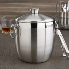 This classic ice bucket & tongs looks beautiful on any table or counter top and is a great option for keeping beverages and cold hors d'oeuvres chilled all evening long. Cooking Supplies, Holiday Looks, Countertops, Bucket, Stainless Steel, Beverages, Cold, Utensils, Confetti