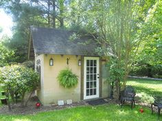 Hometalk -This was an old cinder-block building that was used for storage. She added wood at the top and the gingerbread trim, put a french door from Habitat for Humanity. Put a $10 fan inside & made it her art studio.