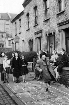 Old photograph of children playing in the street in Glasgow, Scotland
