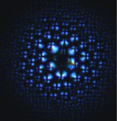 """Scientists grow liquid crystal """"flowers"""" to use as lenses By Lakshmi Sandhana Scientists grow a liquid crystal flower-like structure that allows them to create lenses as complex as an insect's compound eyes (Photo: University of Pennsylvania)"""