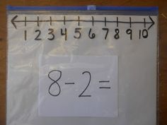 Absolutely Brilliant: Zipper Ziploc as number line marker and problems on a card.