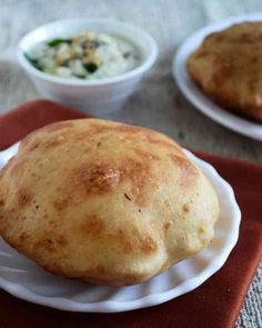 Mangalore Bun / Banana Puri Recipe - Recipe and step wise photos to make the soft mildly sweet puffy golden banana puris from scratch.