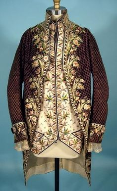 c.1770-1790s French frock coat of dark taupe cut velvet with polychrome floral silk embroidery and ivory silk embroidered waistcoat. Coordinating ivory simple lace at cuffs.